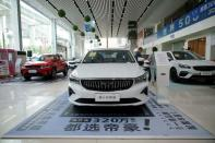 Geely vehicles are displayed at a car dealership in Shanghai
