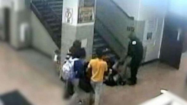 PHOTO: A school resource officer at John Marshall Metropolitan High School in Chicago can be seen dragging a 16-year-old girl down a flight of stairs in a February incident. (WLS)