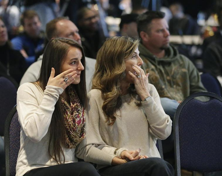 Tina Pagano, right, and her daughter Taylor Pagano, listen as Indianapolis Colts head coach Chuck Pagano speaks during a news conference Monday, Dec. 24, 2012, in Indianapolis. Pagano returns to the team after undergoing successful leukemia treatment. (AP Photo/Darron Cummings)