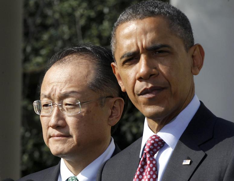 President Barack Obama stands with Jim Yong Kim, his nominee to be the next World Bank President, in the Rose Garden of the White House in Washington, Friday, March 23, 2012. Kim is currently the president of Dartmouth College. (AP Photo/Charles Dharapak)