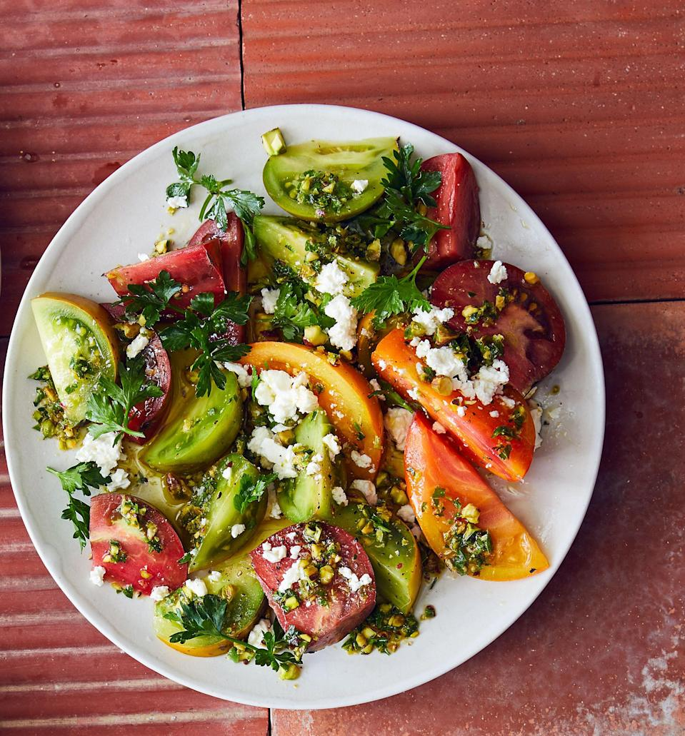 "Serve this salad as soon as it is assembled so all of the tomato juices and flavor stay where they belong. <a href=""https://www.bonappetit.com/recipe/tomato-salad-with-feta-and-pistachios?mbid=synd_yahoo_rss"" rel=""nofollow noopener"" target=""_blank"" data-ylk=""slk:See recipe."" class=""link rapid-noclick-resp"">See recipe.</a>"