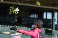 Jockey Joel Rosario tosses flowers in the air after riding Vequist to win the Breeders' Cup Juvenile Fillies horse race at Keeneland Race Course, Friday, Nov. 6, 2020, in Lexington, Ky. (AP Photo/Darron Cummings)