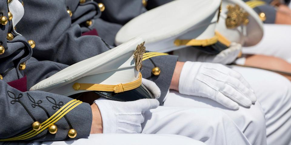 West Point cadets hold their caps on their laps during graduation ceremonies at the United States Military Academy in May 2019.