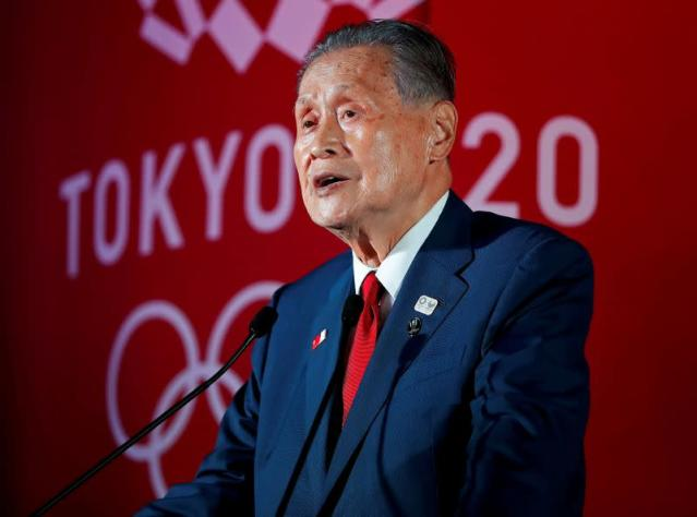 FILE PHOTO: Yoshiro Mori delivers a speech one year out from the start of the summer games in Tokyo