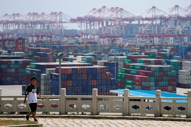 Containers are seen at the Yangshan Deep Water Port in Shanghai