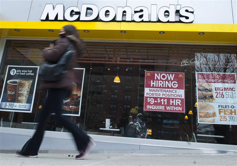 A passersby walks past a McDonald's restaurant in the Brooklyn borough of New York in this file photo taken March 7, 2014. REUTERS/Keith Bedford