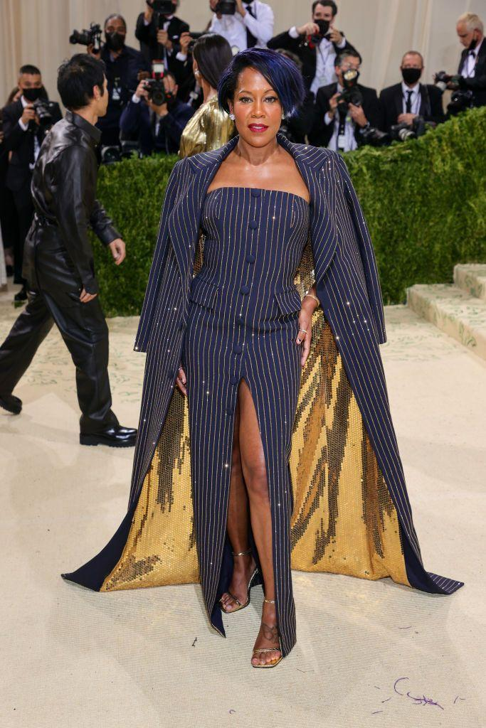 <p>King wore a pinstriped dress and coat by Michael Kors.</p>