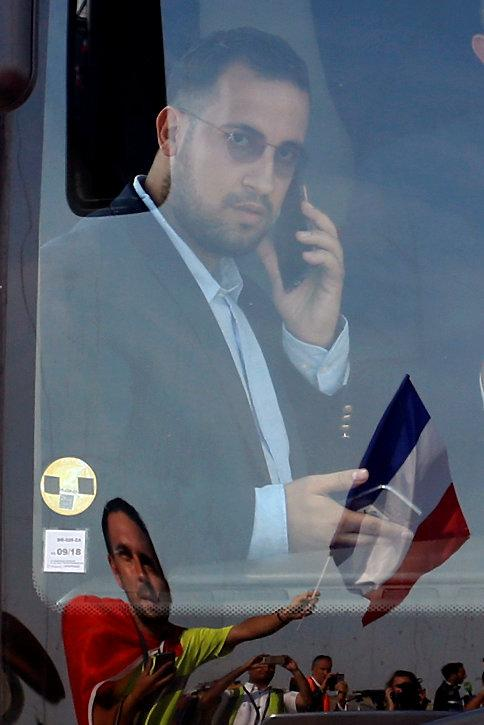 Soccer Football - World Cup - The France team return from the World Cup in Russia - Charles de Gaulle Airport, Roissy, France - July 16, 2018. Alexandre Benalla, French presidential aide for security, rides on the team bus.  Picture taken July 16, 2018. REUTERS/Pascal Rossignol