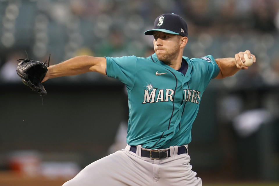 Seattle Mariners' Tyler Anderson pitches against the Oakland Athletics during the first inning of a baseball game in Oakland, Calif., Monday, Sept. 20, 2021. (AP Photo/Jeff Chiu)