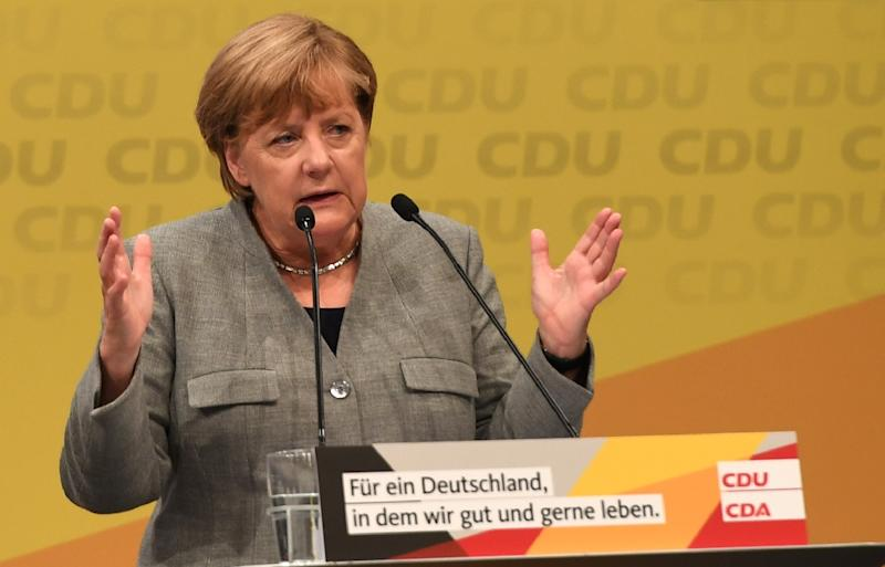 German Chancellor Angela Merkel delivers her first campaign speech ahead of the September 24 general electon with an upbeat message on jobs (AFP Photo/PATRIK STOLLARZ)