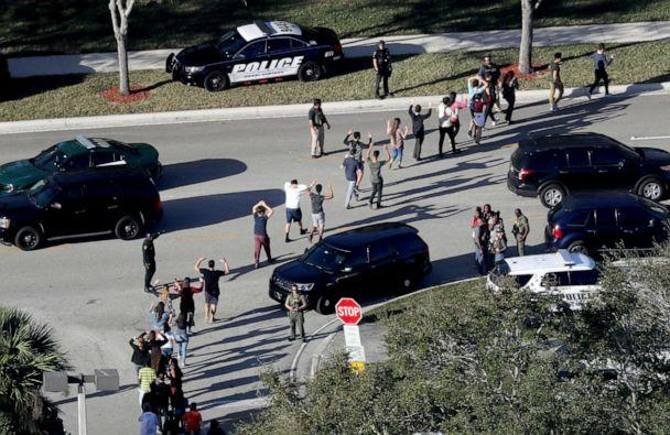 PHOTO: Students hold their hands in the air as they are evacuated by police from Marjory Stoneman Douglas High School in Parkland, Fla., after a shooter opened fire on the campus, Feb.14, 2018. (Mike Stocker/South Florida Sun-Sentinel via AP, FILE)