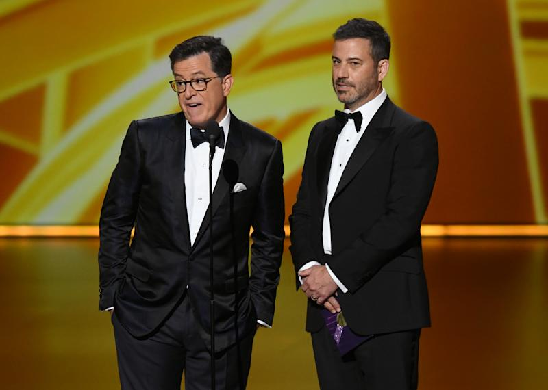 LOS ANGELES, CALIFORNIA - SEPTEMBER 22: (L-R) Stephen Colbert and Jimmy Kimmel speak onstage during the 71st Emmy Awards at Microsoft Theater on September 22, 2019 in Los Angeles, California. (Photo by Kevin Winter/Getty Images)