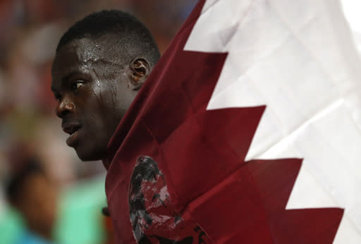 Qatar's Abdalelah Hassan celebrates after winning the men's 400m final during the athletics competition at the 18th Asian Games in Jakarta, Indonesia, Sunday, Aug. 26, 2018. (AP Photo/Bernat Armangue)