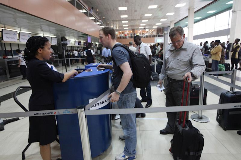 """In this photo taken on Monday, Feb. 4, 2013 passengers lineup to check in for an Air France flight at the Murtala Muhammed International Airport in Lagos, Nigeria. A British national has been kidnapped near Lagos international airport, in Nigeria's commercial capital, the British Consulate-General reported Friday, July 19, 2013. Spokesman Wale Adebayo says diplomats are working with Nigerian authorities on this week's kidnapping. He said he could give no other information because of the """"sensitive nature"""" of the issue. (AP Photo/Sunday Alamba)"""