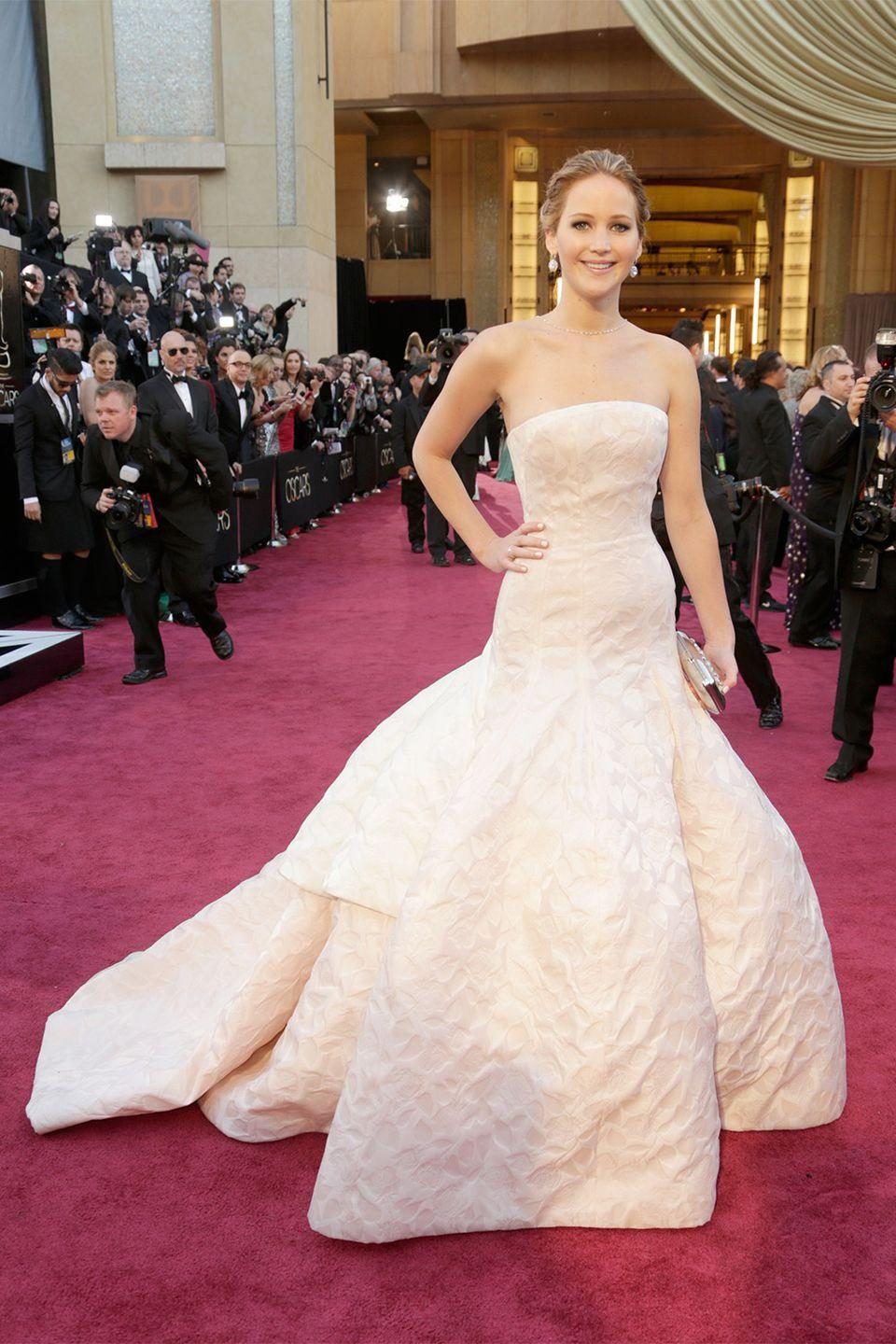 <p>Since becoming the face of Dior in 2012, the French brand has dressed Jennifer Lawrence for all the important occasions in her life—including her 2013 Oscar win. And who could forget her graceful fall as she made her way up to the stage to accept her award?</p>
