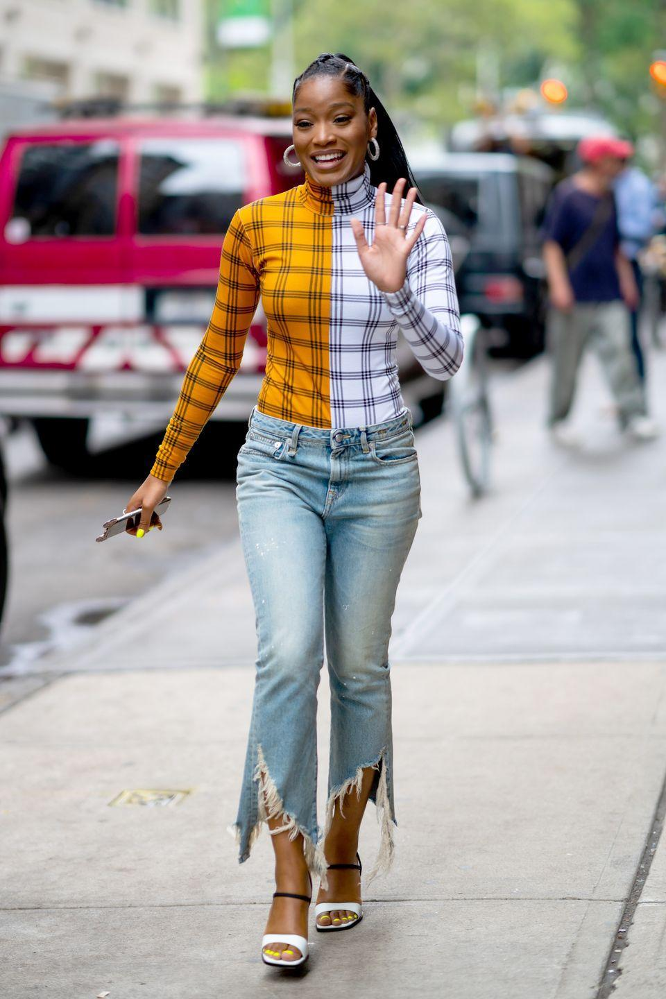 <p>This split look is HOT for fall 2021. With a statement-making top like this, you can go very laid-back with the rest of your look – like jeans and sneakers. </p>