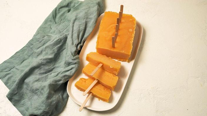 """<p>We're going to let you in on a little secret: A loaf pan is just as good as a popsicle mold!<br></p><p>Get the recipe from <a href=""""https://www.delish.com/cooking/recipe-ideas/a32936218/loaf-pan-mango-pops-recipe/"""" rel=""""nofollow noopener"""" target=""""_blank"""" data-ylk=""""slk:Delish"""" class=""""link rapid-noclick-resp"""">Delish</a>.</p>"""