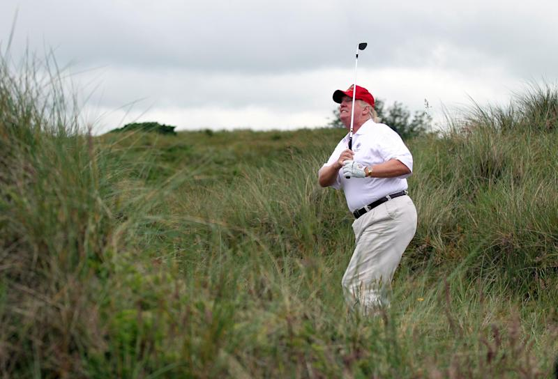 Mr Trump playing golf in Balmedie, Scotland: Getty Images