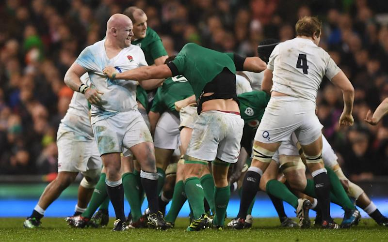 Dan Cole of England tussles with CJ Stander  - Credit: GETTY