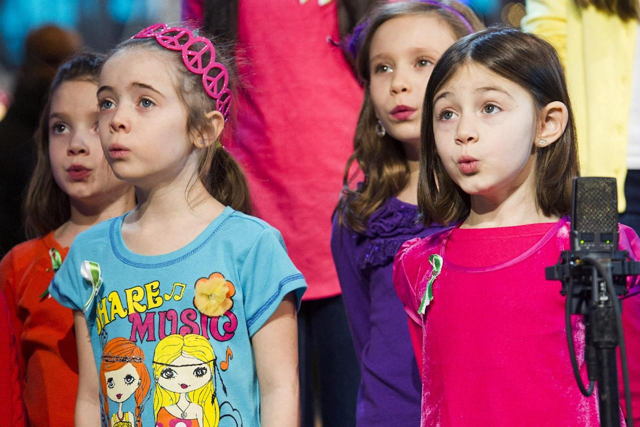 "Children from Newtown, Conn. and Sandy Hook Elementary school perform ""Somewhere Over the Rainbow"" on ABC's ""Good Morning America"" on Tuesday, Jan. 15, 2013 in New York. (Photo by Charles Sykes/Invision/AP)"