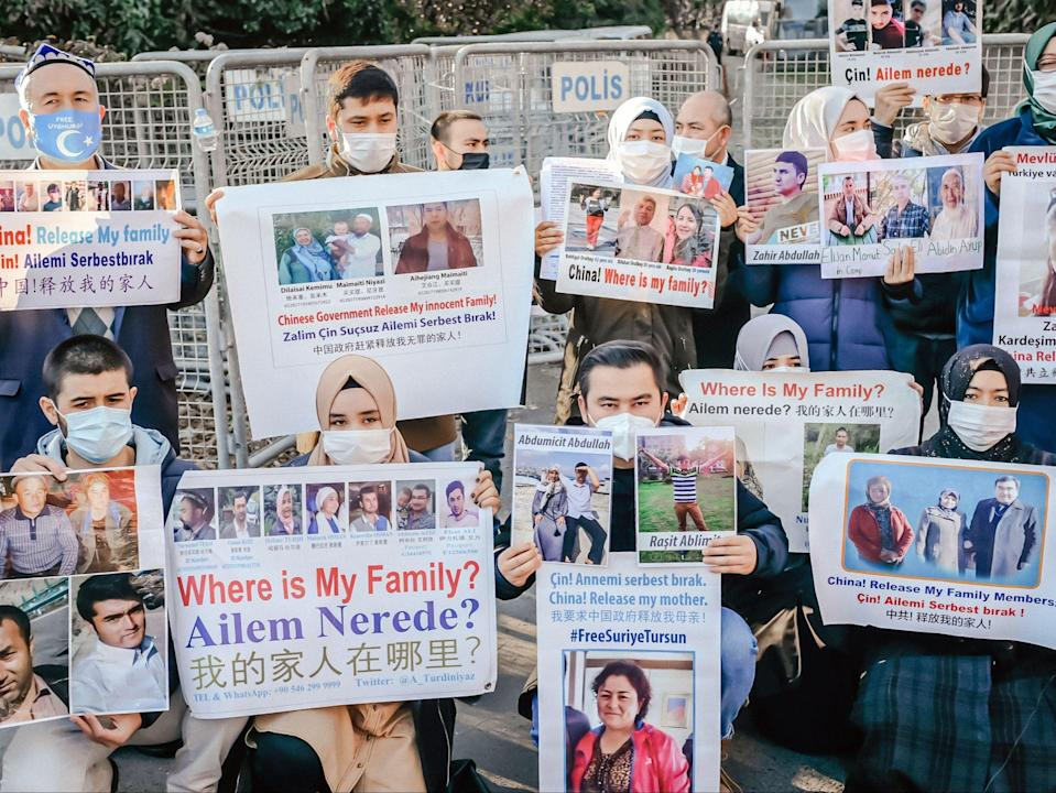 Uighurs demonstrate in front of the Chinese consulate in Istanbul to ask for news of their relatives (AFP via Getty Images)