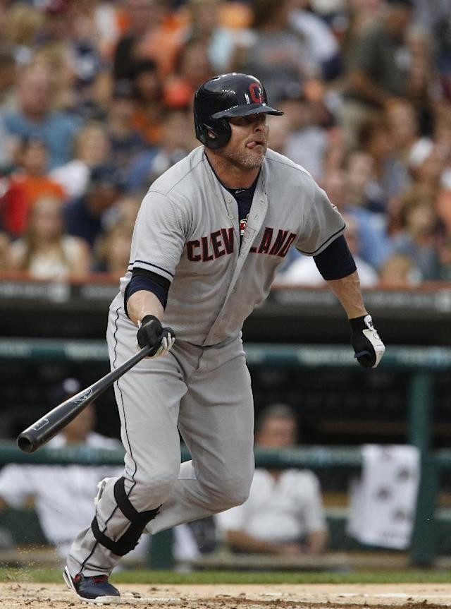 FILE - In this Aug. 31, 2013 file photo, Cleveland Indians' Jason Giambi watches his fly ball for the second out of the second inning during a baseball game against the Detroit Tigers in Detroit. The Indians have released controversial closer Chris Perez and re-signed veteran slugger Jason Giambi. Giambi provided leadership to the Indians from the moment he arrived at training camp last spring. (AP Photo/Duane Bureson, File)
