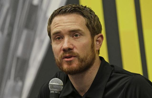 Sprint Cup driver Brian Vickers speaks to the media during a press conference at Martinsville Speedway in Martinsville, VA., Sunday, Oct. 27, 2013. (AP Photo/Steve Helber)