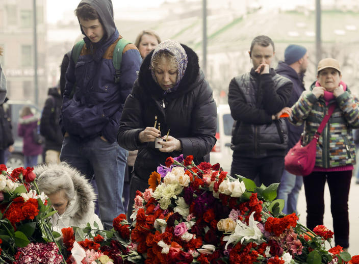 <p>A woman lights a candle at a symbolic memorial at Sennaya subway station in St. Petersburg, Russia, Tuesday, April 4, 2017. A bomb blast tore through a subway train deep under Russia's second-largest city St. Petersburg Monday, killing several people and wounding many more in a chaotic scene that left victims sprawled on a smoky platform. (Dmitri Lovetsky/AP) </p>
