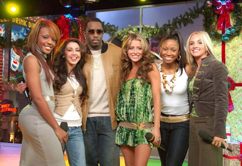 "(From left) Dawn Richard, Aundrea Fimbres, Sean Combs, Aubrey O'Day, D. Woods and Shannon Bex on ""TRL"" in 2005. (Michael Loccisano via Getty Images)"