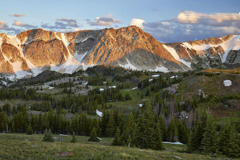 """<p><strong>The Drive:</strong> <a href=""""https://www.tripadvisor.com/Attraction_Review-g60438-d1992974-Reviews-Snowy_Range_Scenic_Byway-Centennial_Wyoming.html"""" rel=""""nofollow noopener"""" target=""""_blank"""" data-ylk=""""slk:Snowy Range Scenic Byway"""" class=""""link rapid-noclick-resp"""">Snowy Range Scenic Byway</a></p><p><strong>The Scene:</strong> As the second highest highway in the state, this byway crosses from Interstate 80 about 20 miles east of Rawlins through jaw-dropping alpine habitats. </p><p><strong>The Pit-Stop:</strong> Stop in the tiny town of <a href=""""https://www.tripadvisor.com/Tourism-g60438-Centennial_Wyoming-Vacations.html"""" rel=""""nofollow noopener"""" target=""""_blank"""" data-ylk=""""slk:Centennial"""" class=""""link rapid-noclick-resp"""">Centennial</a> to take a break and grab a bite. </p>"""