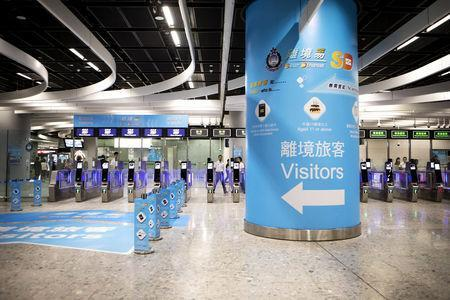 Automated immigration clearance machines for departing passengers stand in the Hong Kong Port Area at West Kowloon Station, which houses the terminal for the Guangzhou-Shenzhen-Hong Kong Express Rail Link (XRL), developed by MTR Corp., in Hong Kong, China, September 22, 2018. Giulia Marchi/Pool via REUTERS