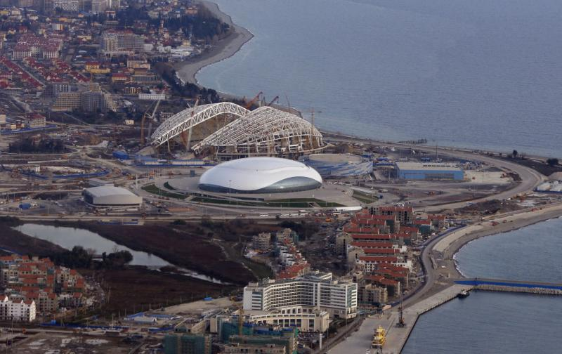 FILE - This Feb. 4, 2013 file photo shows an aerial view of the Olympic Park under construction for the Winter Olympics in Sochi, Russia. The 2014 Winter Olympics will kick off on Feb. 7, 2014. You'd have to be a dope to try to get away with doping at the Sochi Olympics. That's the picture painted by international Olympic and anti-doping officials as they implement the toughest drug-testing program in Winter Games history.Using intelligence to target athletes and events considered most at risk, authorities are focusing their efforts on weeding out drug cheats through rigorous pre-games and pre-competition tests. (AP Photo/Dmitry Lovetsky, File)