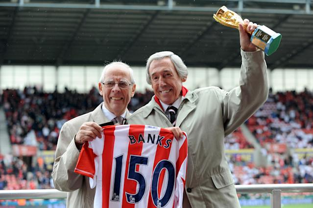 Former Stoke City goalkeeper Gordon Banks holds the Jules Rimet trophy as he is awarded a a Stoke City shirt before the game.