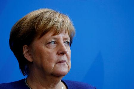 FILE PHOTO - German Chancellor Angela Merkel looks during the presentation of a new 2 Euro commemorative coin in Berlin