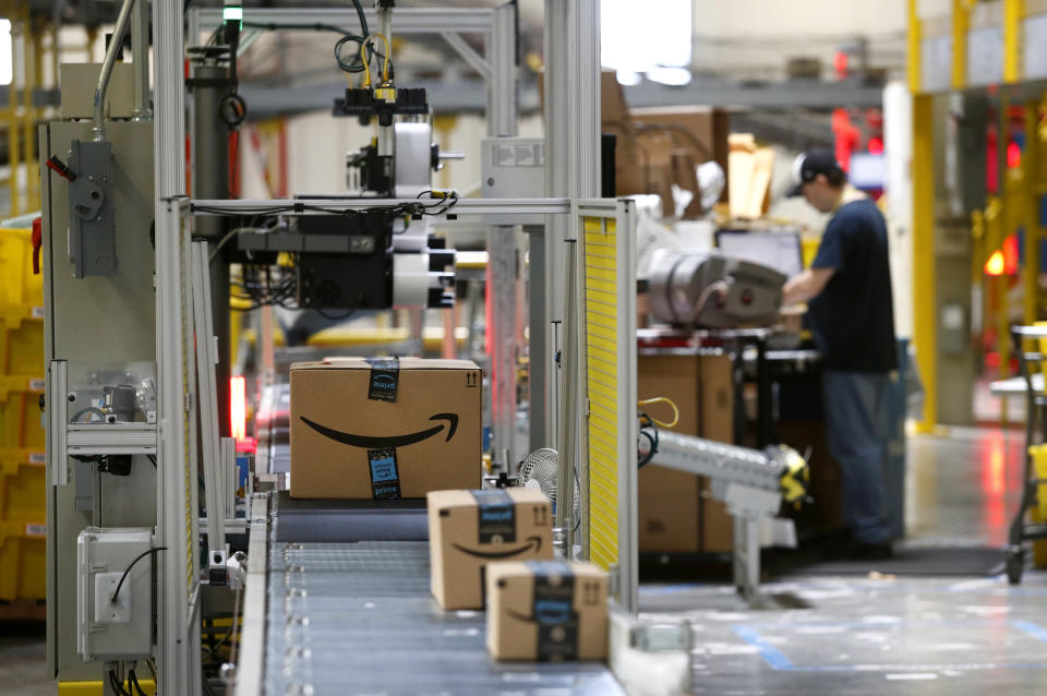 FILE- In this Aug. 3, 2017, file photo, packages pass through a scanner at an Amazon fulfillment center in Baltimore. Amazon will spend more than $700 million to provide additional training to about one-third of its U.S. workforce. (Photo/Patrick Semansky, File)