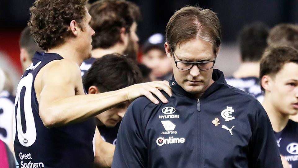 David Teague, pictured here being consoled by Charlie Curnow during Carlton's clash with GWS.