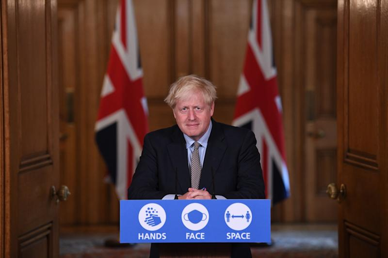 Britain's Prime Minister Boris Johnson speaks during a virtual press conference at Downing Street in central London on September 9, 2020 following an announcement of further restrictions on social gatherings in England due to an uptick in cases of the novel coronavirus. - The UK government on on September 9 sets out tighter rules on social gatherings to curb the spread of the coronavirus, with concern mounting at rising infection rates among the young. The law in England will change from next week to reduce the number of people who can gather socially from 30 to six, with some exemptions. (Photo by Stefan Rousseau / POOL / AFP) (Photo by STEFAN ROUSSEAU/POOL/AFP via Getty Images)