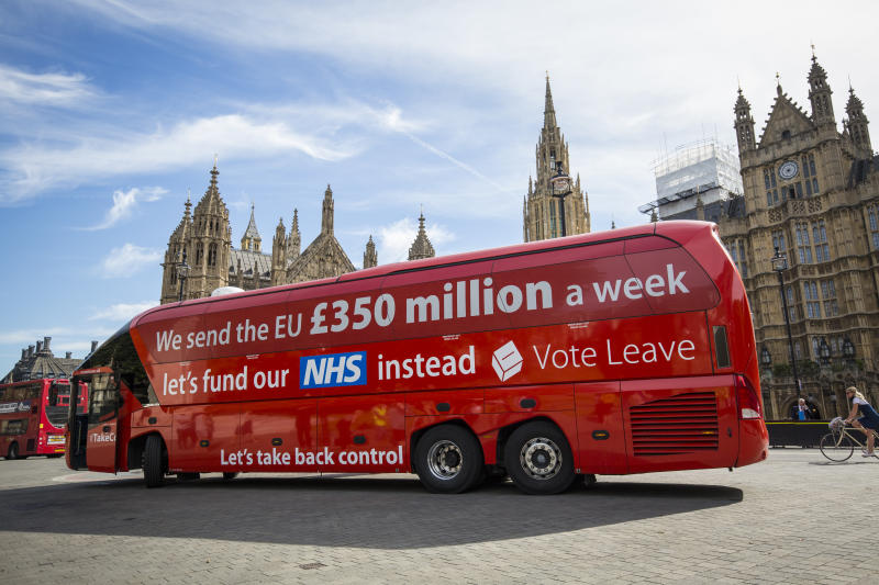 "LONDON, ENGLAND - JULY 18: A 'Vote LEAVE' battle bus is parked outside the Houses of Parliament in Westminster by the environmental campaign group Greenpeace before being re-branded on July 18, 2016 in London, England. The bus which was used during the European Union (EU) referendum campaign and had the statement ""We send the EU £350 million a week let's fund our NHS instead"" along the side was today covered with thousands of questions for the new Prime Minister Theresa May and her government about what a 'Brexit' might mean for the environment. (Photo by Jack Taylor/Getty Images)"