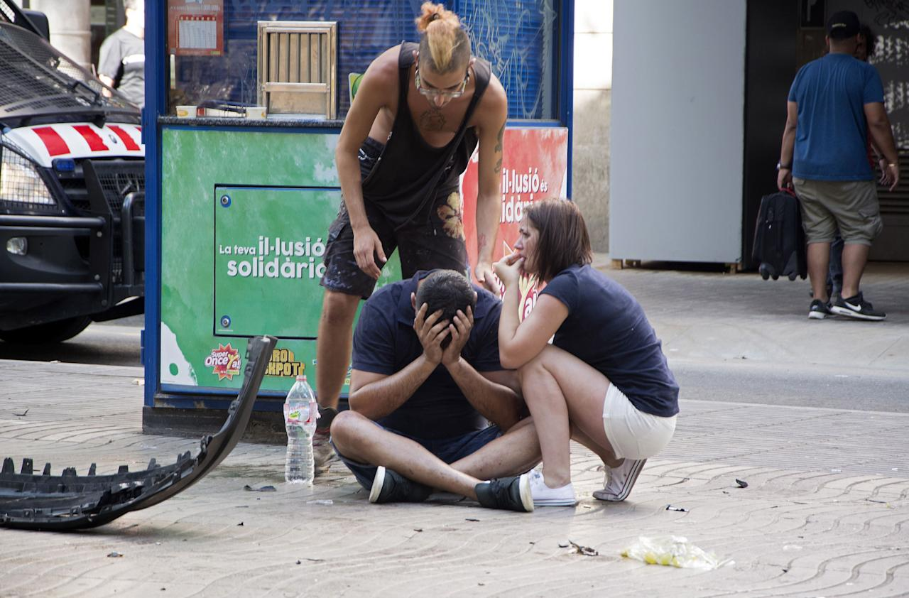 <p>Injured people react after a van crashed into pedestrians in Las Ramblas, downtown Barcelona, Spain, August 17, 2017. (David Armengou/EPA/REX/Shutterstock) </p>