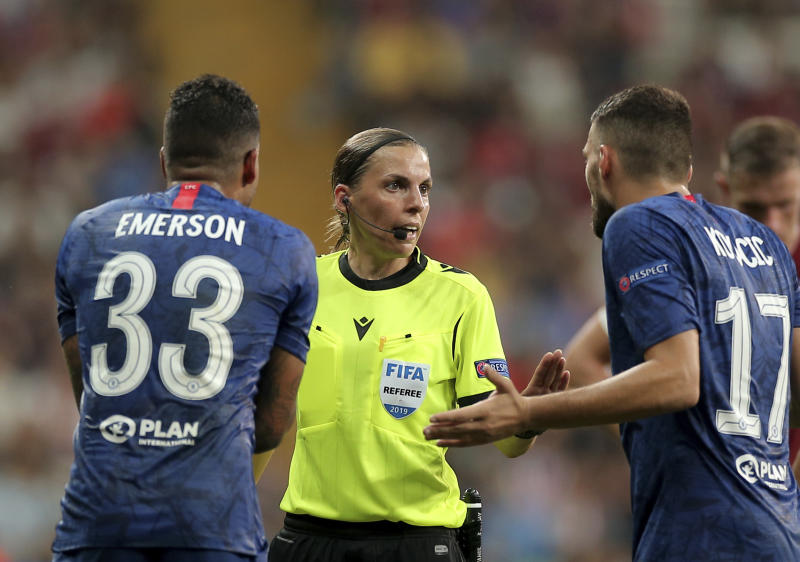 Referee Stephanie Frappart of France, center, discusses with Chelsea's Emerson Palmieri, left, and Chelsea's Mateo Kovacic during the UEFA Super Cup soccer match between Liverpool and Chelsea, in Besiktas Park, in Istanbul, Wednesday, Aug. 14, 2019. (AP Photo)