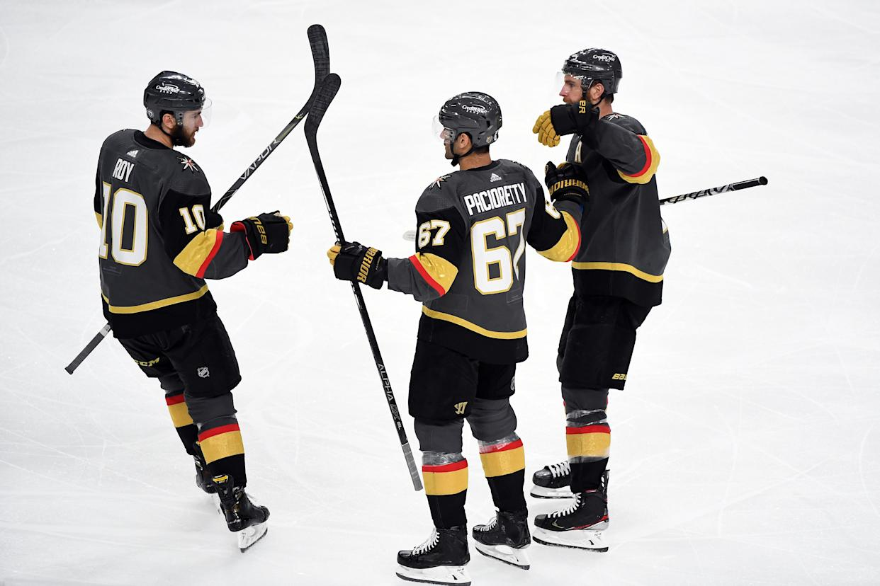 LAS VEGAS, NEVADA - JUNE 22:  Max Pacioretty #67 of the Vegas Golden Knights is congratulated by Nicolas Roy #10 and Alex Pietrangelo #7 after scoring a goal against the Montreal Canadiens during the third period in Game Five of the Stanley Cup Semifinals of the 2021 Stanley Cup Playoffs at T-Mobile Arena on June 22, 2021 in Las Vegas, Nevada. (Photo by Sam Morris/Getty Images)