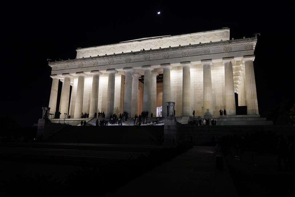 Vice President Kamala Harris and her husband Doug Emhoff wait at the Lincoln Memorial for fireworks to begin Wednesday, Jan. 20, 2021, in Washington. (AP Photo/Jacquelyn Martin)