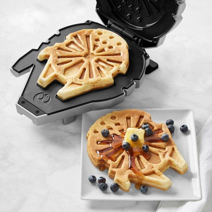 "<p><strong>Williams-Sonoma</strong></p><p>williams-sonoma.com</p><p><strong>$49.95</strong></p><p><a href=""https://go.redirectingat.com?id=74968X1596630&url=https%3A%2F%2Fwww.williams-sonoma.com%2Fproducts%2Fstar-wars-millennium-falcon-waffle-maker&sref=https%3A%2F%2Fwww.goodhousekeeping.com%2Fholidays%2Fgift-ideas%2Fg29624061%2Fstar-wars-gifts%2F"" rel=""nofollow noopener"" target=""_blank"" data-ylk=""slk:Shop Now"" class=""link rapid-noclick-resp"">Shop Now</a></p><p>Go from batter to waffle in 12 parsecs. This waffle maker looks like the Millennium Falcon when closed, and also makes Falcon-shaped waffles. It's the best breakfast in the galaxy!</p>"