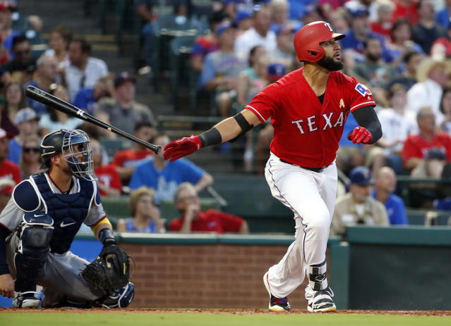 FILE - In this Sept. 1, 2018, file photo, Texas Rangers right fielder Nomar Mazara (30) watches the flight of his solo home run against the Minnesota Twins during the second inning of a baseball game, in Arlington, Texas. Mazara, still only 23, has had exactly 20 homers in each of his three seasons. (AP Photo/Michael Ainsworth, File)