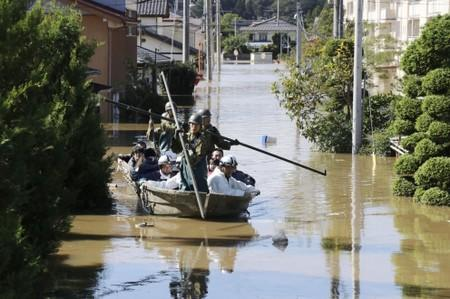 Japan sends in troops after deadly typhoon floods towns, threatens more damage