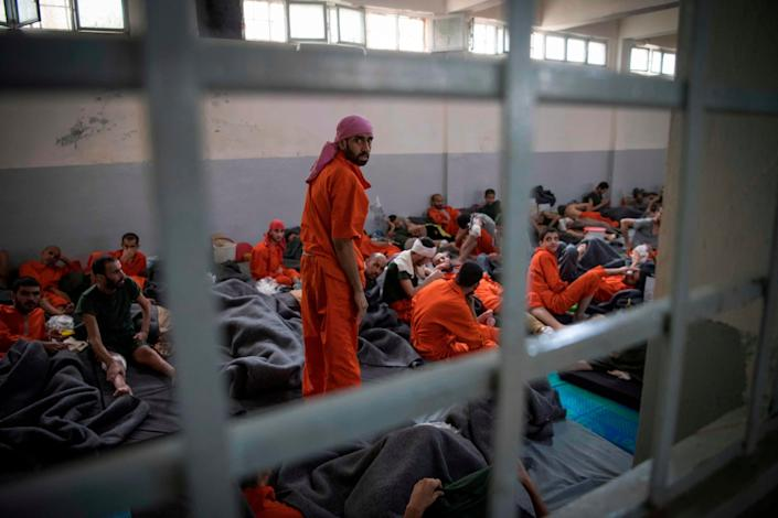 Men allegedly affiliated with Isis sit on the floor in a prison in the northeastern Syrian city of Hassakeh: AFP