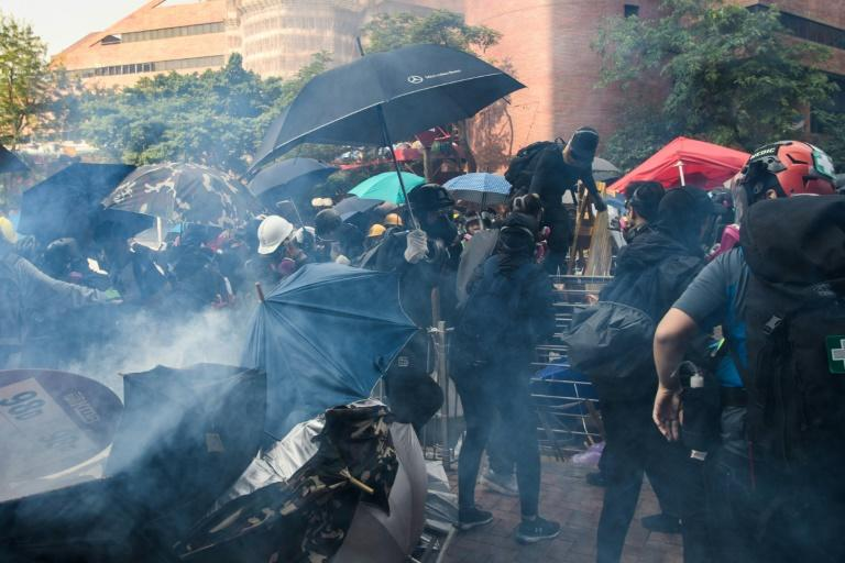 Some protesters made a dash for escape (AFP Photo/ANTHONY WALLACE)