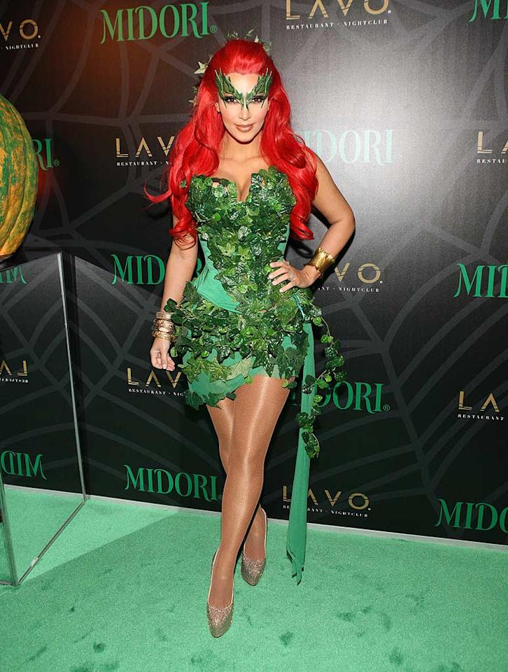 At Lavo in Sin City, Kim Kardashian flew solo dressed as Batman villainess Poison Ivy. Rumor has it that she filed for divorce from Kris Humphries, her hubby of 72 days, just this morning! (10/29/2011)