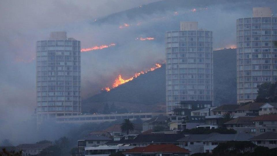 Flames are seen close to the city fanned by strong winds after a bushfire broke out on the slopes of Table Mountain in Cape Town, South Africa, April 19, 2021