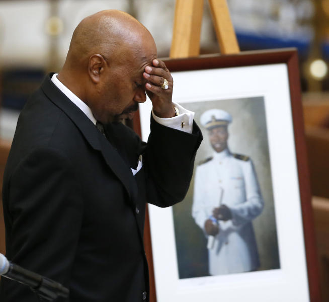 Kerwin Miller, a United States Naval Academy graduate and friend of Lt. Cmdr. Wesley Brown, the first African-American to graduate from the Academy, reacts as he walks past Brown's picture during a memorial service in Annapolis, Md., Wednesday, June 6, 2012. Brown was a veteran of World War II, the Korean War and the Vietnam War before retiring from the Navy in 1969. (AP Photo/Patrick Semansky)